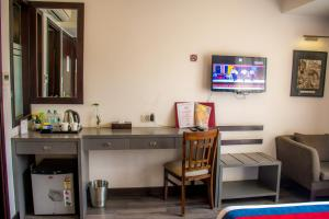 A television and/or entertainment centre at M Hotel Thamel-Kathmandu