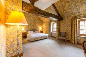 Un ou plusieurs lits dans un hébergement de l'établissement Château De Marçay