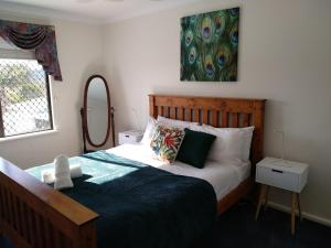A bed or beds in a room at holiday house