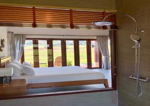 A bed or beds in a room at 180 Sanctuary at Puripai Villa