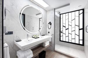 Un baño de Hotel Riu Palace Oasis