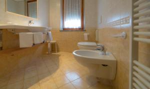 Bagno di Hotel Beau Sejour Pré-Saint-Didier