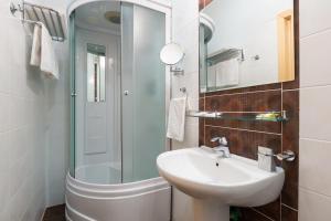 Ванная комната в Резидент Отель