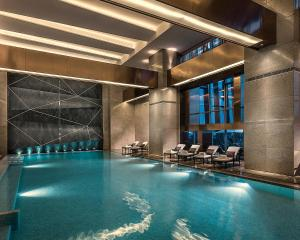 The swimming pool at or near Four Seasons Hotel Shenzhen