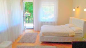 Ein Bett oder Betten in einem Zimmer der Unterkunft Agava