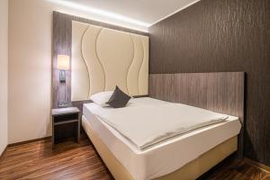 Ein Bett oder Betten in einem Zimmer der Unterkunft Best Western PLAZA Hotel Grevenbroich