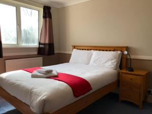 A bed or beds in a room at Florence Court Andover