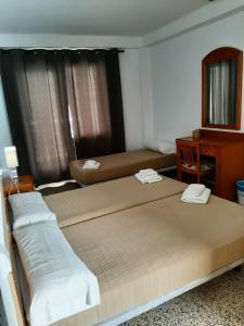 Un ou plusieurs lits dans un hébergement de l'établissement Hostal Tierramar