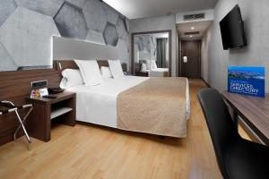 A bed or beds in a room at HCC Montblanc