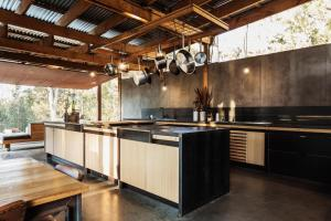A kitchen or kitchenette at Bay of Fires Bush Retreat