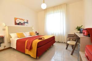 A bed or beds in a room at Hotel Del Buono Wellness & Spa