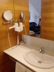 Ванная комната в Hotel Eisenhuthaus