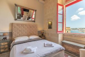 Un ou plusieurs lits dans un hébergement de l'établissement Luciano Al Porto Boutique