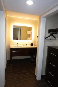 A bathroom at Hawthorn Suites by Wyndham Detroit Southfield