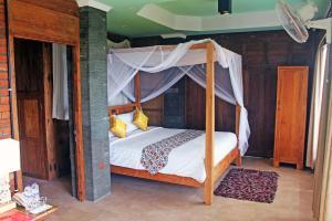 سرير أو أسرّة في غرفة في Ti Amo Bali