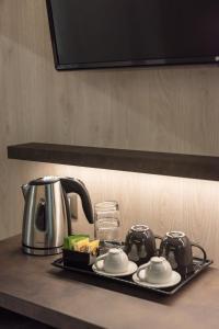 Set per la preparazione di tè e caffè presso Le Nove Muse Guesthouse