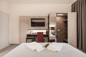 Letto o letti in una camera di Le Nove Muse Guesthouse
