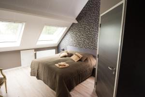 Een bed of bedden in een kamer bij B&B Groot Pepersgoed