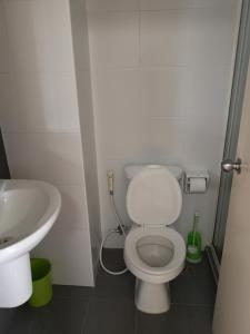 A bathroom at comfy deluxe one bedroom