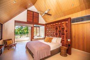 A bed or beds in a room at Niramaya Villas and Spa