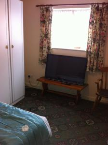 A television and/or entertainment centre at The Black Horse Inn