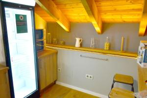 A kitchen or kitchenette at Albergue Alda Pilgrim León