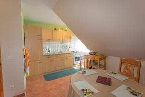 Küche/Küchenzeile in der Unterkunft Ferienwohnung auf Rügen