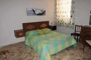 A bed or beds in a room at CASA CALISI