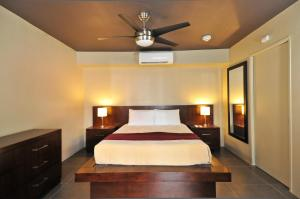A bed or beds in a room at Bearfoot Inn - Clothing Optional Hotel for Gay Men