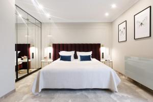 A bed or beds in a room at Queen Boutique Hotel