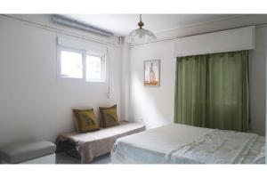 A bed or beds in a room at Athens, Cholargos metro appartment (1 to 6 persons)