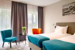 A bed or beds in a room at Focus Hotel Premium Lublin