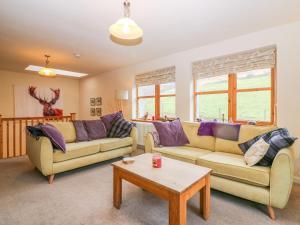 A seating area at Drimnatorran Farm Lodge