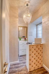 A kitchen or kitchenette at Riva Palace - design rooms