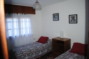 A bed or beds in a room at Hosteria La casa de Ketty