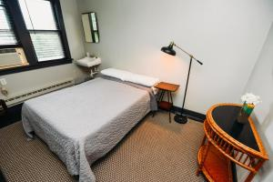 A bed or beds in a room at Rainbow Mountain Resort - LGBTQ Friendly