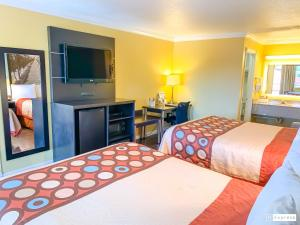 A bed or beds in a room at Super 8 by Wyndham Ukiah