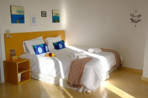 A bed or beds in a room at Hotel Wakim