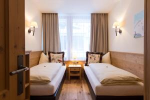 A bed or beds in a room at Chalet Anna Maria