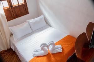 A bed or beds in a room at Santa Lucia de la villa