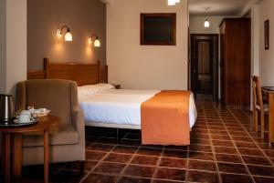 Cama o camas de una habitación en La Fragua II