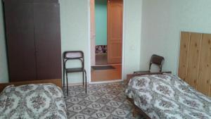 Кровать или кровати в номере Gostinitsa Mayak