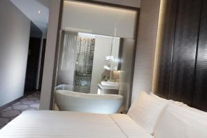 A bed or beds in a room at Dorsett Singapore (SG Clean)