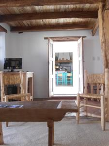 The lounge or bar area at Hosteria Villa Cardon