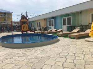 The swimming pool at or close to Guesthouse Orion