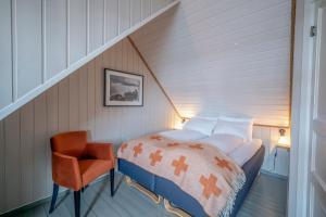 Ein Bett oder Betten in einem Zimmer der Unterkunft Nyvågar Rorbuhotell - by Classic Norway Hotels