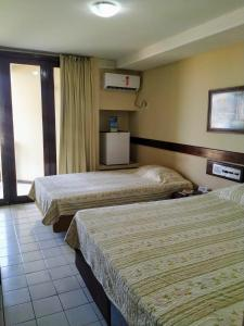 A bed or beds in a room at Sol Praia Marina Hotel