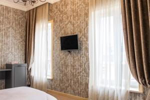 Телевизор и/или развлекательный центр в Hotel DaLi