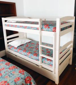 Uma ou mais camas em beliche num quarto em Domus Avocat
