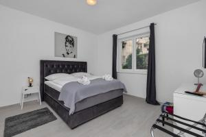 A bed or beds in a room at Apartments Morpheus